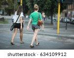 Two Women In Shorts Cross The...