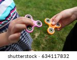 Two Fidget Spinners