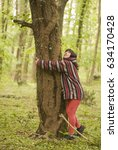 Woman Wearing Hoodie Hugging A...