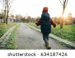 kid running at sunset | Shutterstock . vector #634187426