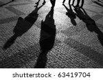 shadows of people walking in a... | Shutterstock . vector #63419704