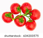 wet bio tomatoes group with drops, isolated on white background, without shadow. Top view. Group of ripe fresh wet tomatoes, macro, overhead shot. Delicious tomatoes from farm on white backdrop.
