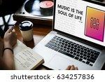hands working on laptop network ... | Shutterstock . vector #634257836