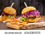 two sandwiches with pulled pork ... | Shutterstock . vector #634280555