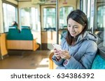asian woman use of mobile phone | Shutterstock . vector #634386392