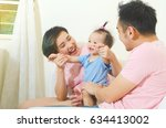 asian parent playing with their ... | Shutterstock . vector #634413002
