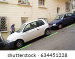 Barcelona, Spain - June 10, 2011: Uphill street with parking lot on a slant in Barcelona - stock photo