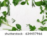 green fresh herbs mix on white... | Shutterstock . vector #634457966