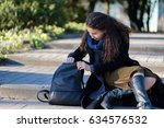 a girl with long hair is... | Shutterstock . vector #634576532