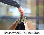closeup of woman holding... | Shutterstock . vector #634586306