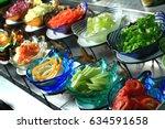 salad bar veggies and fruits    Shutterstock . vector #634591658