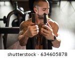 young bodybuilder doing heavy... | Shutterstock . vector #634605878