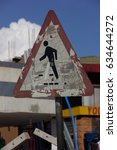 Small photo of Beat up pedestrian sign