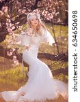 beautiful blond girl in blossom ... | Shutterstock . vector #634650698