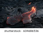 black lava field with hot red... | Shutterstock . vector #634686536