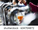 pouring beer in a glass | Shutterstock . vector #634704872