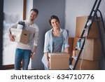 happy young couple unpacking or ... | Shutterstock . vector #634710776