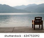 only one chair on the deck with ... | Shutterstock . vector #634752092