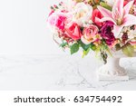 bouquet flowers in vase... | Shutterstock . vector #634754492