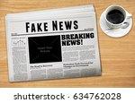 a newspaper showing 'fake news' ... | Shutterstock . vector #634762028