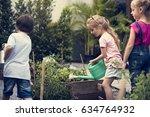 Group Of Children Watering...