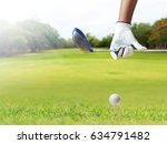golf player holding a golf club ... | Shutterstock . vector #634791482