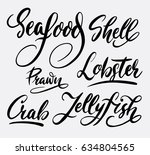 seafood and lobster hand... | Shutterstock .eps vector #634804565