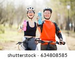 Bicyclists With Bottles Of Water