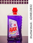 Small photo of POZNAN, POLAND - AUGUST 26, 2015: Ajax floor cleaning liquid in a bottle