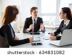 group of business people at a... | Shutterstock . vector #634831082