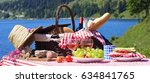picnic in french alpine mountain | Shutterstock . vector #634841765