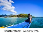 tourist sitting and enjoying on ... | Shutterstock . vector #634849796