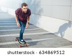hipster man riding skateboard.... | Shutterstock . vector #634869512