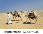 Unknown Men With Camels Near...