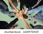group of people holding hand... | Shutterstock . vector #634970435