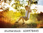 cute child  boy  having fun on... | Shutterstock . vector #634978445