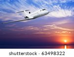 airliner flying above tropical...   Shutterstock . vector #63498322