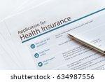 health insurance paper form...   Shutterstock . vector #634987556