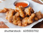 fried chicken nuggets and chili ... | Shutterstock . vector #635003702