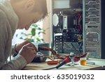 man repairman is trying to fix... | Shutterstock . vector #635019032