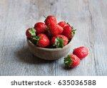 ripe strawberries in a wooden... | Shutterstock . vector #635036588
