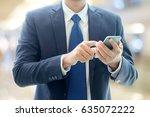 business man hands using smart... | Shutterstock . vector #635072222