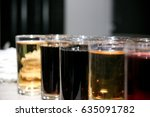 Small photo of a variety of carbonated soda drinks lined up at a open bar