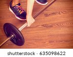 young woman raises barbell from ... | Shutterstock . vector #635098622