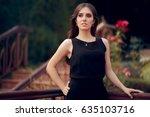 elegant woman wearing black... | Shutterstock . vector #635103716