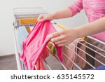 female hands with wet clothes.... | Shutterstock . vector #635145572