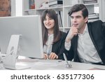 two business people at monitor... | Shutterstock . vector #635177306