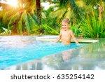 cheerful boy standing in the...   Shutterstock . vector #635254142