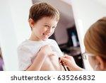 little smiling boy child is...   Shutterstock . vector #635266832