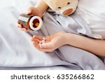 sick child boy takes medication ... | Shutterstock . vector #635266862